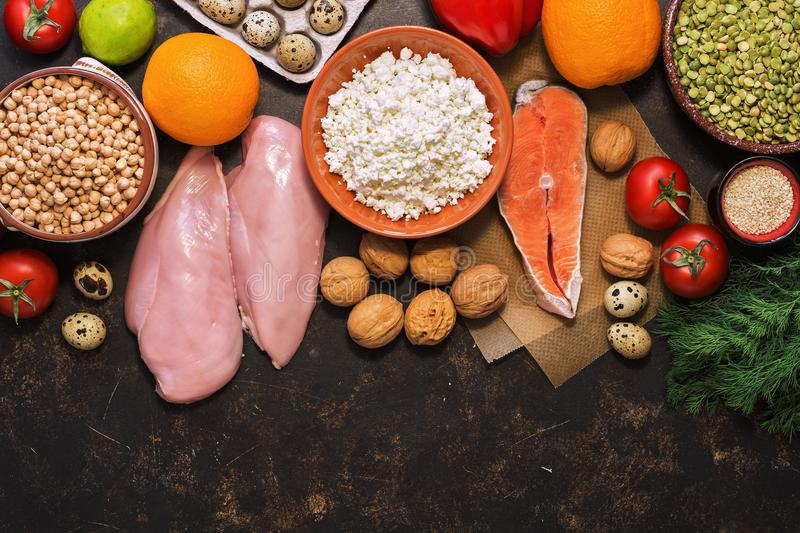 Healthy food on a dark background, salmon, chicken fillet, fruits, vegetables, cereals, cottage cheese. Top view, space for text. stock photos