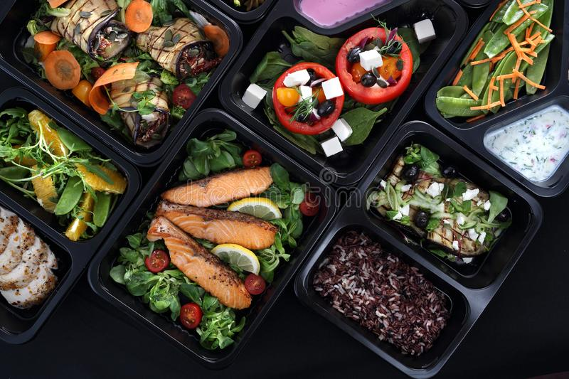 Lunch boxes, delicious and healthy dinner dishes. Food with delivery. Menu suggestions in catering with delivery. royalty free stock photo