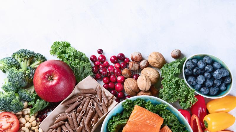Healthy food with dietary fiber, antioxidants. Minerals and vitamins. Detox and clean eating concept. Top view with copy space stock photos