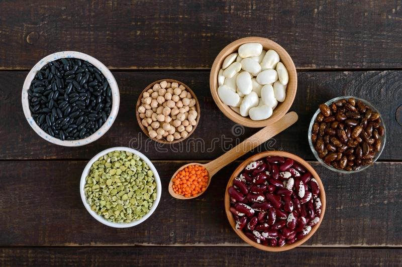 Healthy food, dieting, nutrition concept, vegan protein source. Assortment of colorful raw legumes stock photography