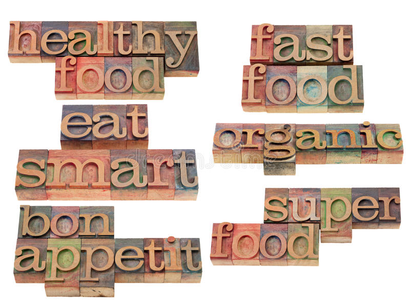 Healthy food - eat smart. Healthy food, eat smart, organic, bo appetit - healthy lifestyle concept - collage of isolated words and phrases in vintage wood royalty free stock image