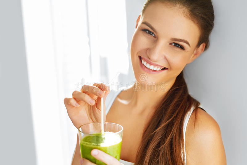 Healthy Food Eating. Woman Drinking Smoothie. Diet. Lifestyle. N. Healthy Food Eating. Happy Beautiful Smiling Woman Drinking Green Detox Vegetable Smoothie royalty free stock image