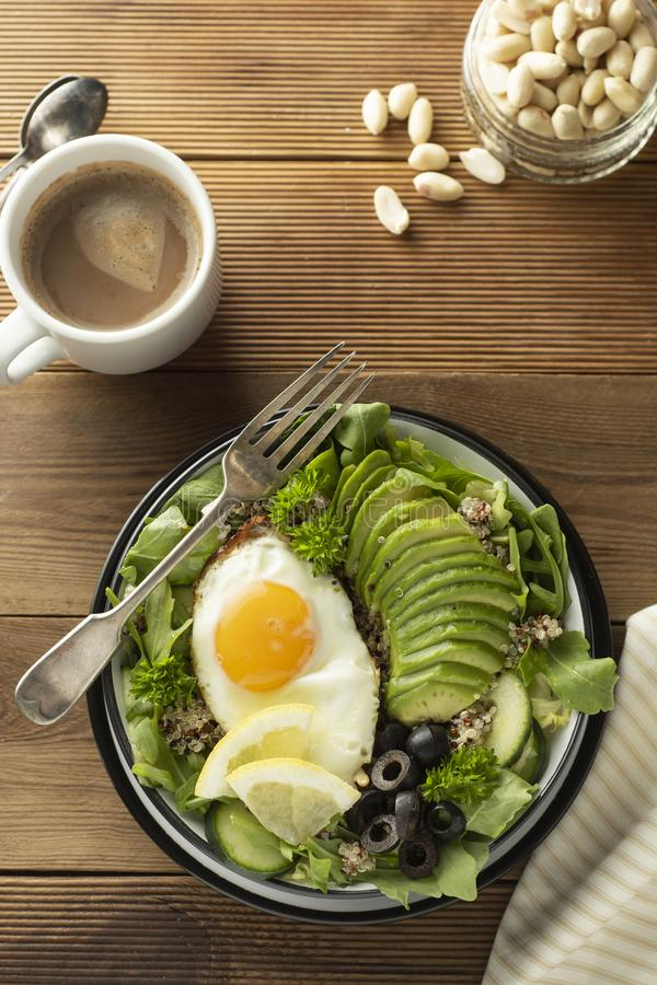 Healthy food. Eggs, quinoa, avocado, green salad, black olives. Wooden table. diet, lose weight. Healthy food. Eggs, quinoa, avocado, green salad, black olives royalty free stock image