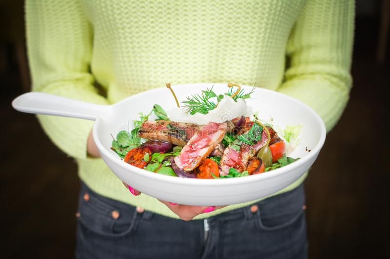 Healthy food on exclusive Italian cuts, fish, lettuce and tomatoes, balsamic vinegar stock image