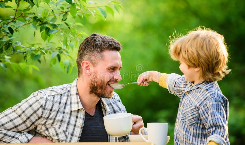Healthy food. Family day bonding. father and son eat outdoor. small boy child with dad. they love eating together. Weekend breakfast. organic and natural food royalty free stock images