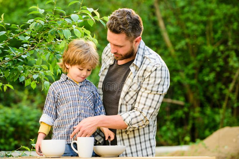 Healthy food. Family day bonding. small boy child with dad. they love eating together. Weekend breakfast. organic and. Natural food. father and son eat outdoor stock images