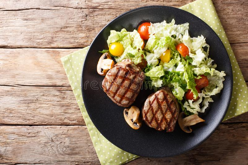 Healthy food: filet mignon steak with mushrooms and vegetable sa stock photo