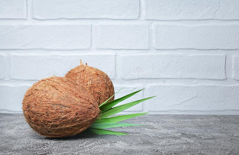Healthy food. Fresh coconut with green palm leaves royalty free stock image