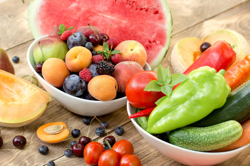 Healthy food - fresh organic fruits and vegetables on rustic table royalty free stock photography