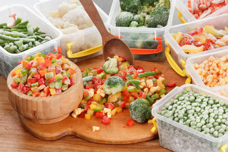 Healthy food frozen vegetables. Cooking ingredients. Healthy food frozen vegetables. Cooking ingredients packaging in container royalty free stock photography