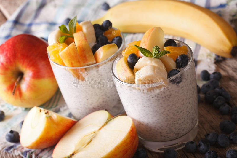 Healthy food: fruit, yogurt and seeds Chia in a glass closeup. H stock photography