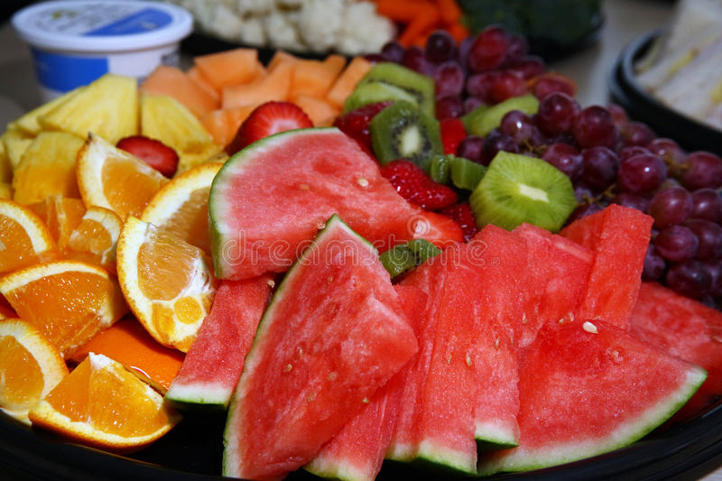 Healthy food, fruits. Fresh sliced fruits at the buffet, healthy food royalty free stock image