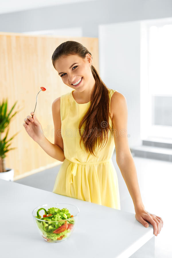 Healthy Food. Girl Eating Vegetable Vegetarian Salad. Lifestyle, Diet Concept. Healthy Food. Close Up Of Happy Smiling Girl Eating Vegetable Vegetarian Salad In royalty free stock photos