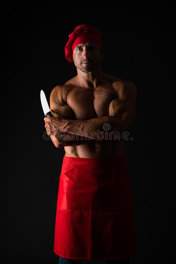 Healthy food for good body. brutal butcher. food additives. sexy man cook isolated on black. butcher with knife. man. With muscular torso in chef apron. cuisine stock photo