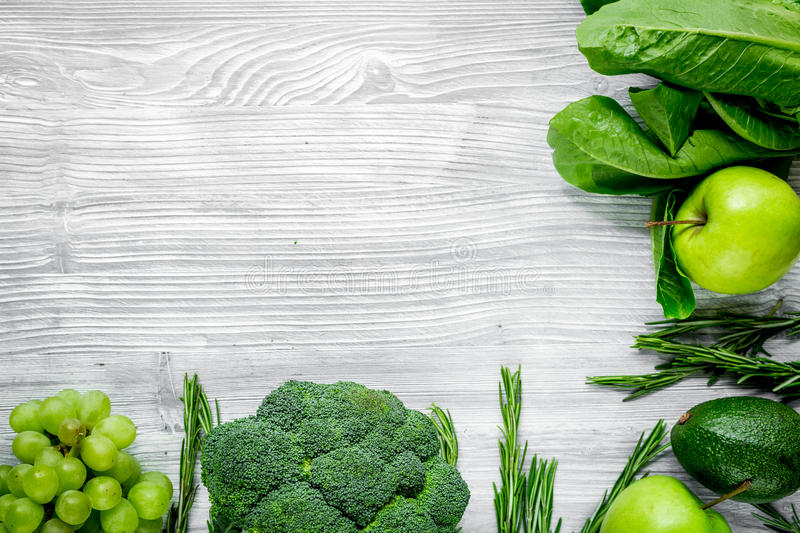 Healthy food with green vegetables, fruits for dinner on gray table background top view mock up. Healthy food with green vegetables, fruits for fitness dinner on stock image
