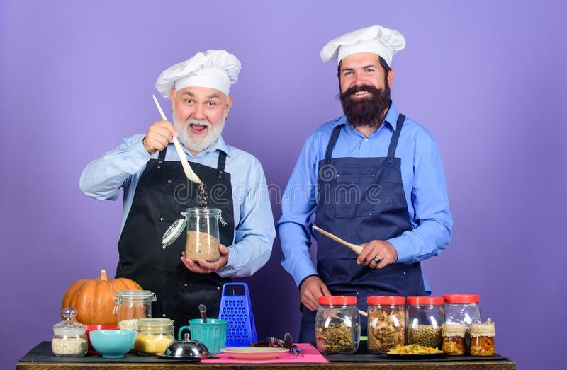 Healthy food is healthy life. Chef men cooking. Healthy food cooking. Halloween pumpkin recipe. bearded men in kitchen royalty free stock photos