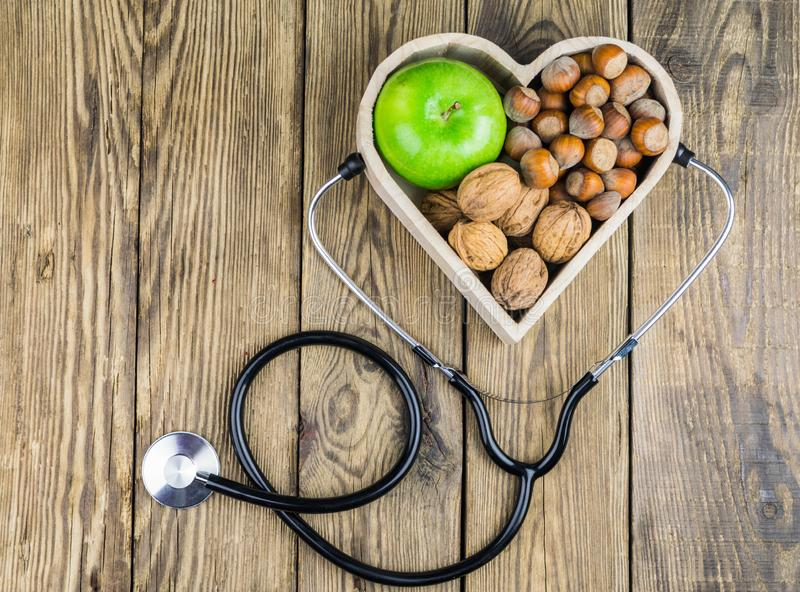 Healthy food in heart and cholesterol diet concept on wooden background royalty free stock images