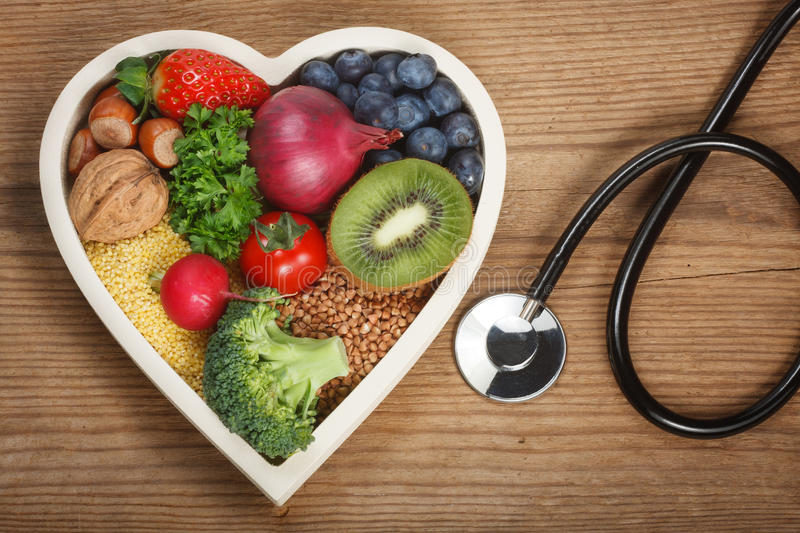 Healthy food in heart shaped bowl.  royalty free stock photography
