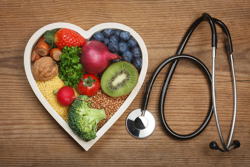 Healthy food in heart shaped bowl stock photo