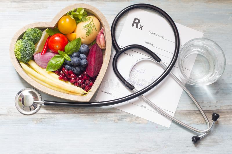 Healthy food in heart stethoscope and medical prescription diet and medicine concept. Closeup stock images