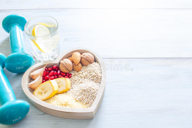 Healthy food in heart and water diet sport concept stock photography