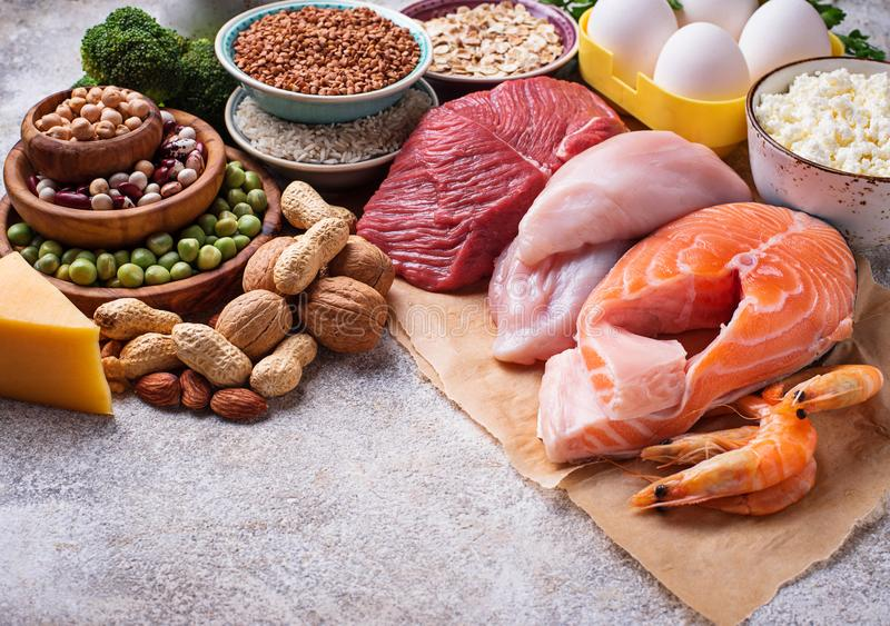 Healthy food high in protein. Meat, fish, dairy products, nuts and beans stock photos