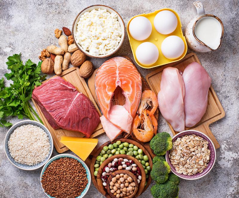 Healthy food high in protein. Meat, fish, dairy products, nuts and beans. Top view stock photos