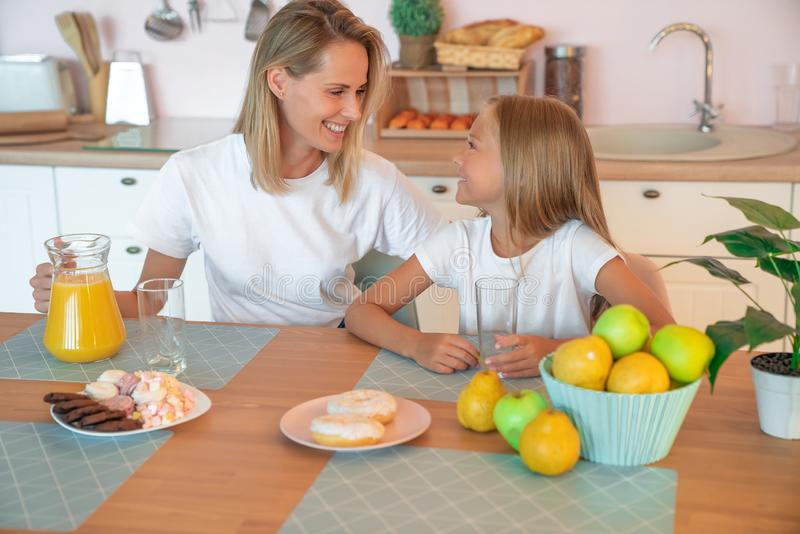 Healthy food at home. Happy family in the kitchen. Mother and child daughter are having breakfast.  stock photos