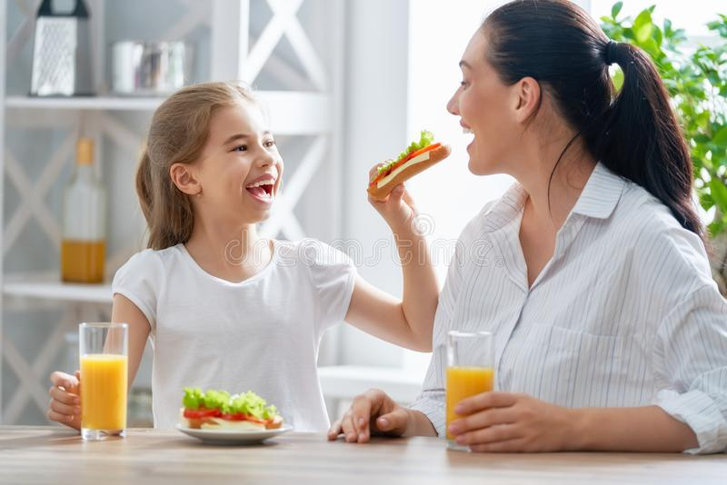 Happy family having breakfast. royalty free stock images