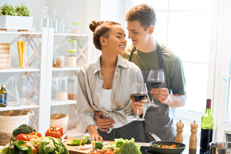Loving couple is preparing the proper meal royalty free stock photo