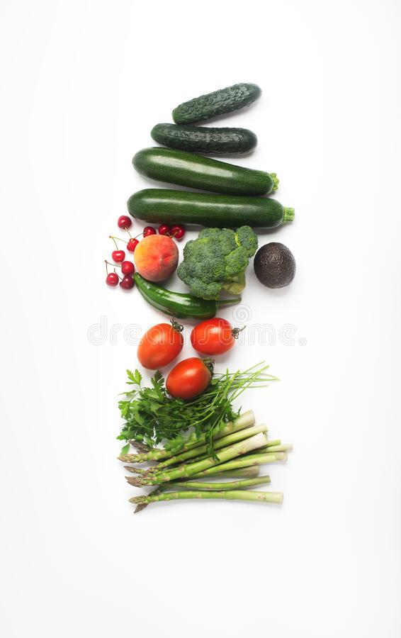 Healthy food, inclufing fruits, vegetables and herbs. On white background, top view, vertical royalty free stock image