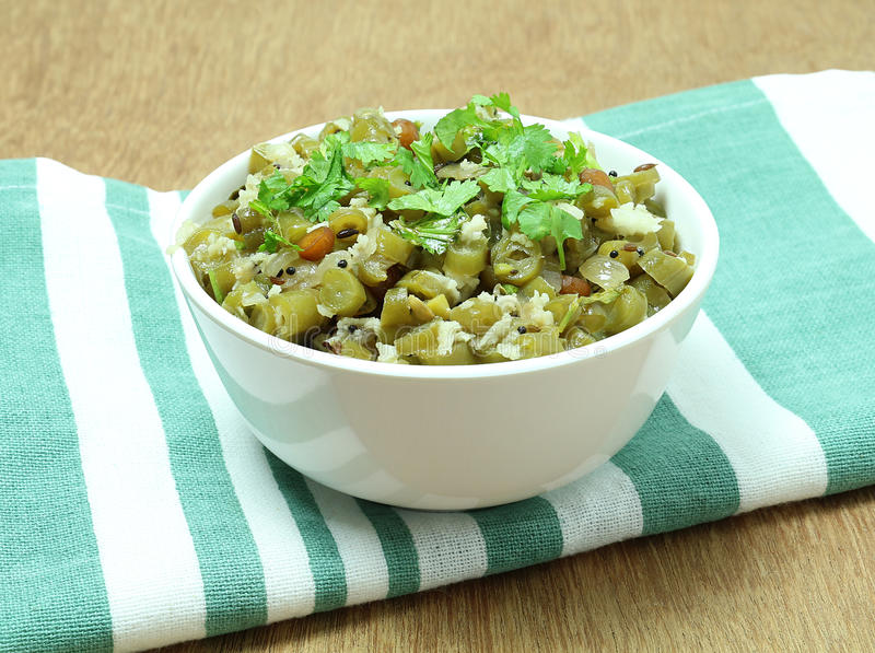 Healthy Food Indian Green Bean Curry. Healthy food Indian green bean vegetarian curry, garnished with coriander leaves, in a bowl stock photo