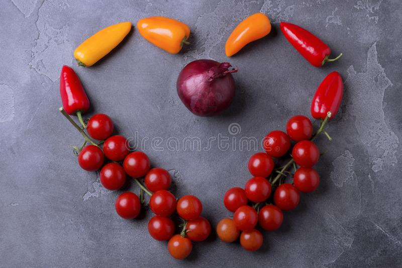 Healthy food ingredients in shape of love heart on dark table. Top view. Concept of vegan - healthy slow food stock photos
