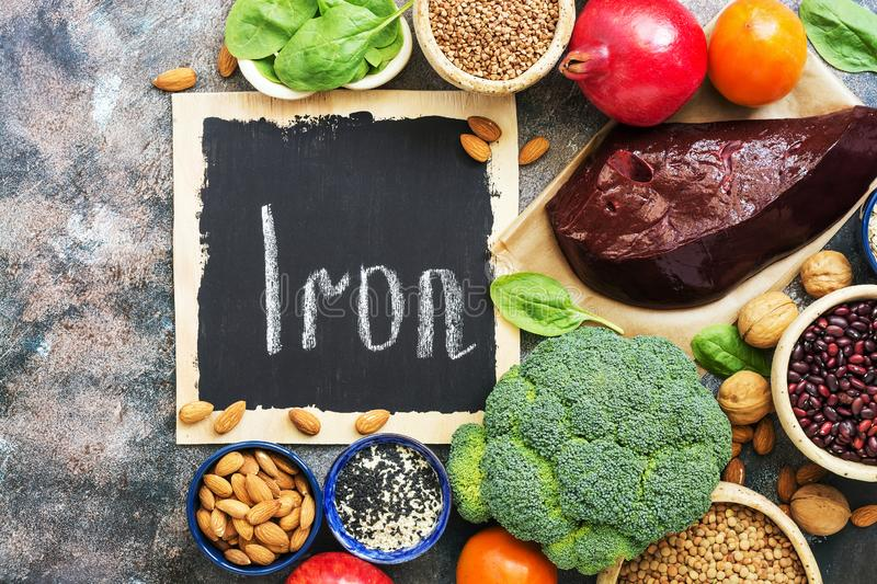 Healthy food with iron content. Vegetables, fruits, beef liver rich in iron on a rustic background. Top view, flat lay, copy space royalty free stock photo