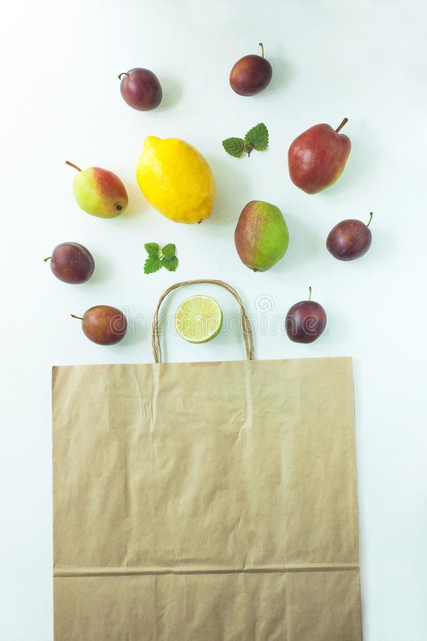 Healthy food in a kraft paper bag. Zero waste concept, colorful reusable eco bags. Healthy food in a kraft paper bag. Zero waste concept, reusable eco pack. Mix stock images