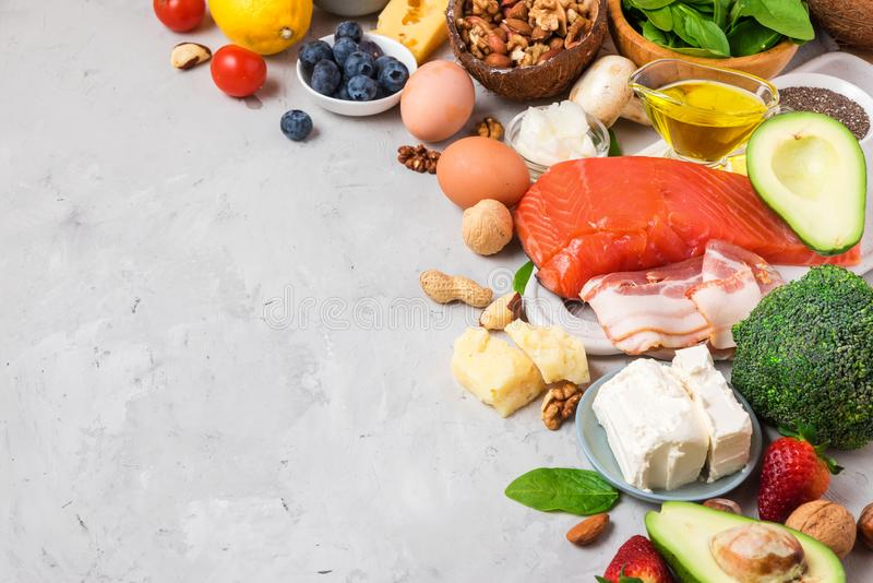 Healthy food low carb keto ketogenic diet. high good fat products. On gray concrete background royalty free stock image