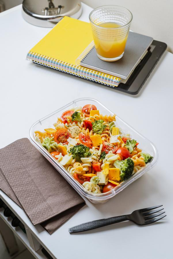 Healthy food in lunch box, on working table with laptop royalty free stock photos