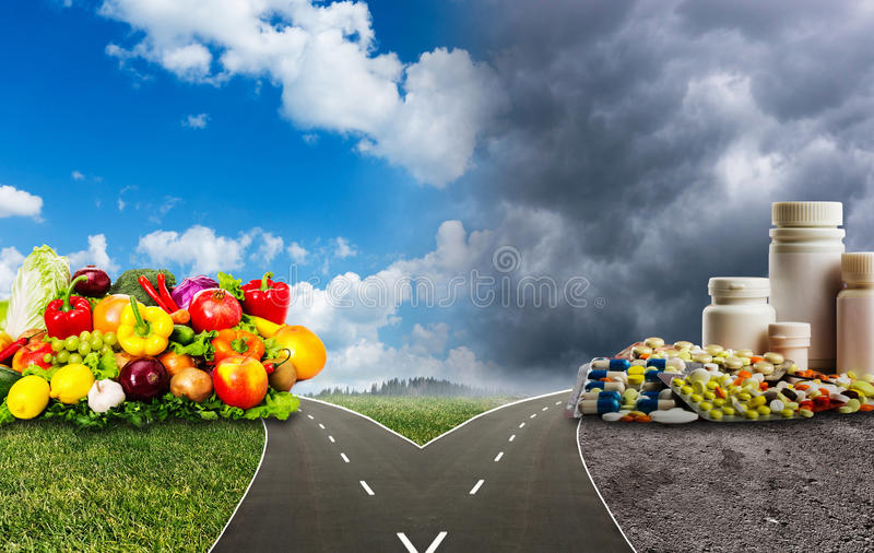 Healthy food or medical pills stock image