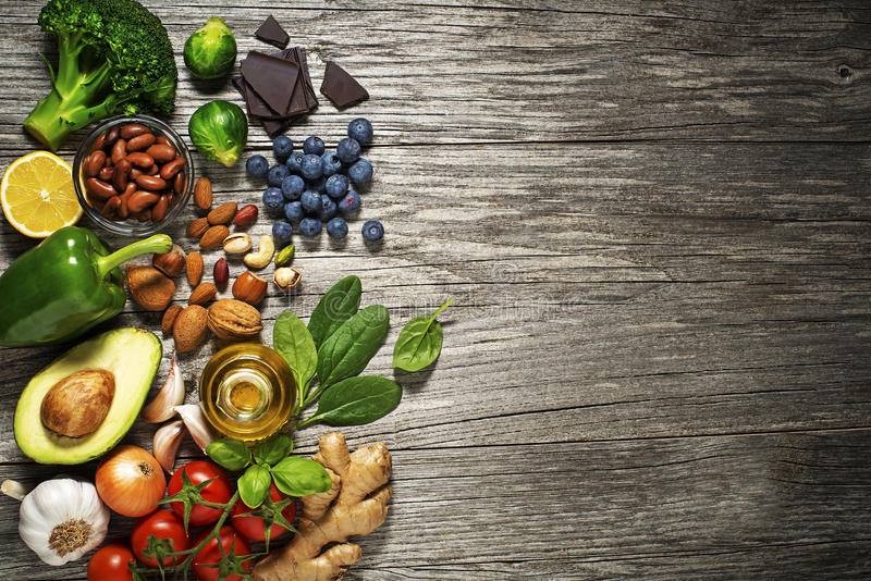 Healthy food. Mixed fresh healthy food on wooden background stock photography