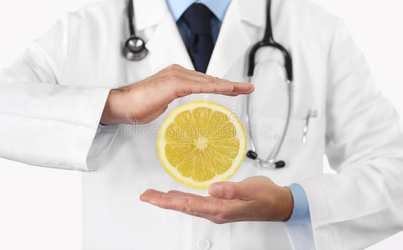 Healthy food and natural nutrition medical diet concept, hands d. Octor with lemon fruit stock photo