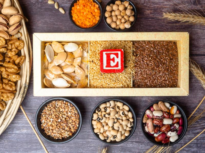 Healthy food nutrition dieting concept. Assortment of high vitamin E sources. nuts, seeds, beans, buckweat, lentils, chickpea,. Healthy fats concept stock image