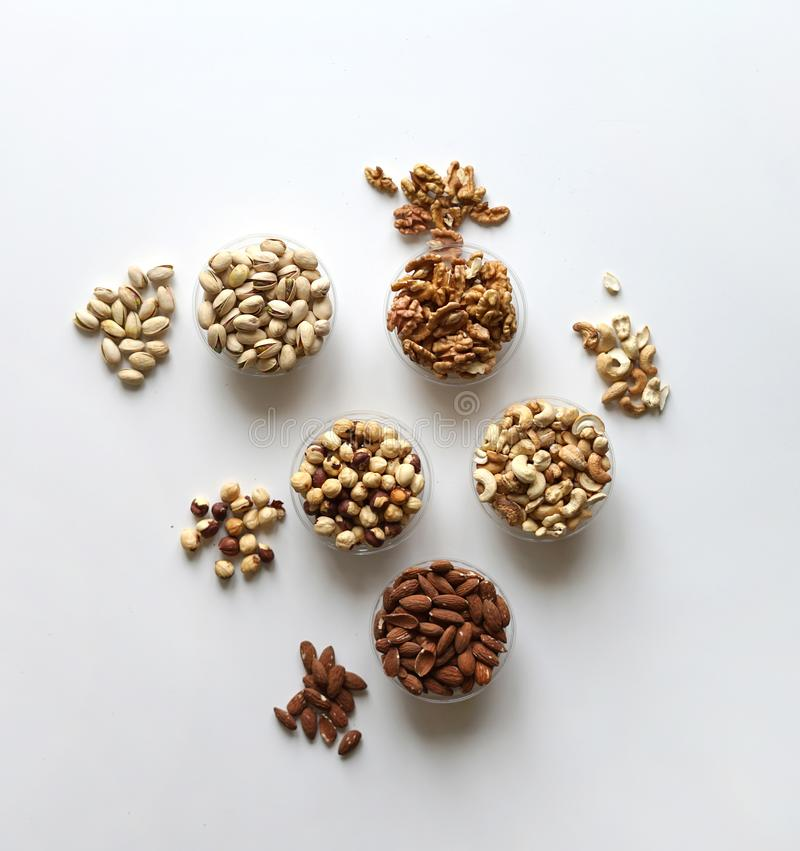 Healthy food. Nuts mix assortment on stone table top view. Collection of different legumes for background image close up nuts, stock photos