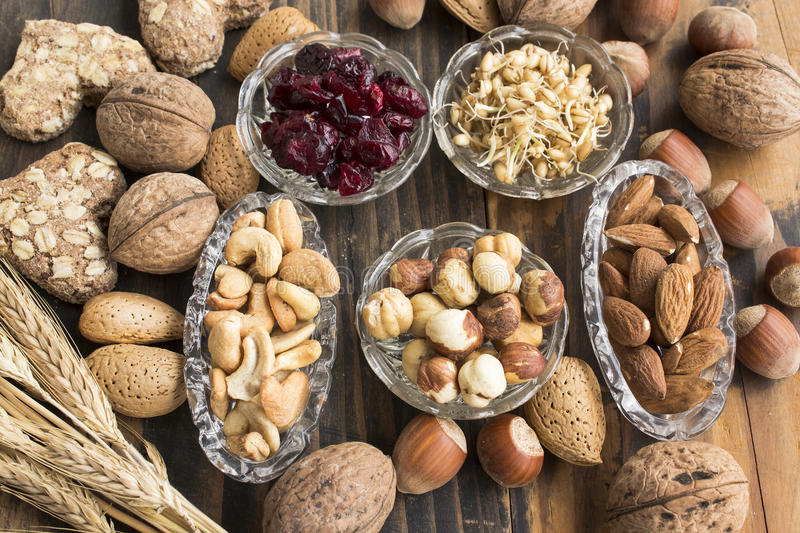 Healthy Food, Nuts, Wheat Germ, Whole Wheat Cookies and Cranberries. No Rustic Wooden Table stock images
