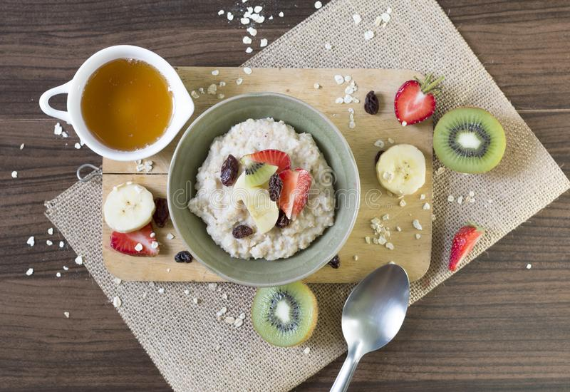 Healthy food,oatmeal breakfast and fruit on wooden background top view close up. stock photos