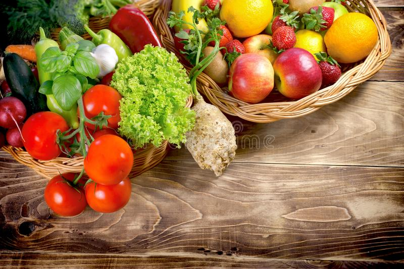 Healthy food, organic fruit and vegetable - healthy eating. Healthy food, organic fruit and vegetable on rustic table - healthy eating royalty free stock image