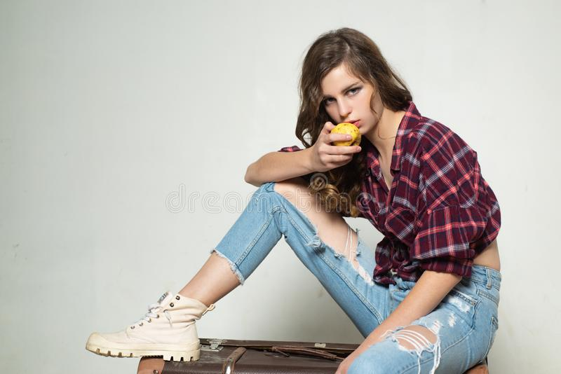 Healthy food. retro fashion model. teen girl in retro clothes. vintage style. denim look. hair fashion. travel with royalty free stock images