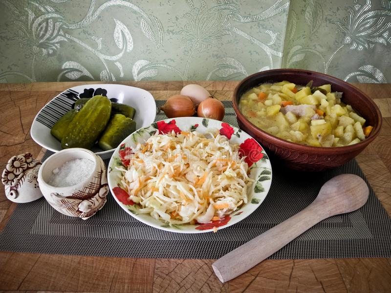 Healthy tasty food, stewed potatoes from the oven, and a snack. royalty free stock images