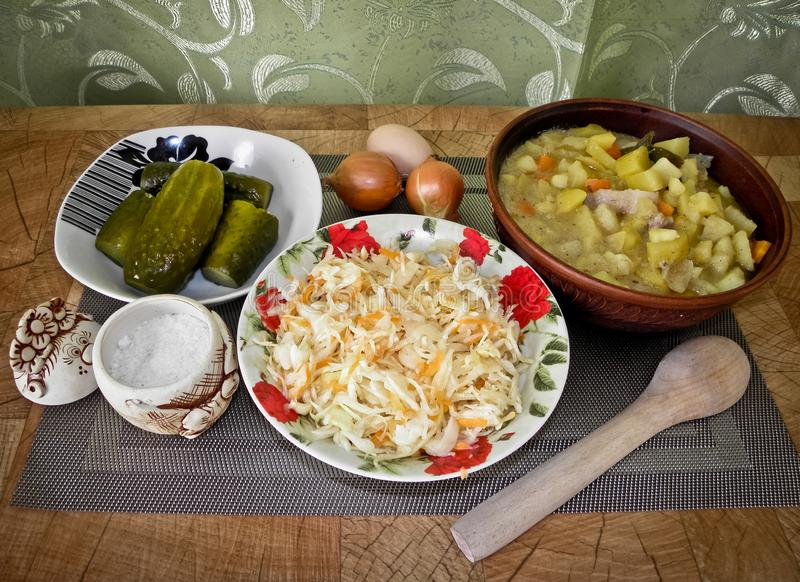 Healthy tasty food, stewed potatoes from the oven, and a snack. stock images