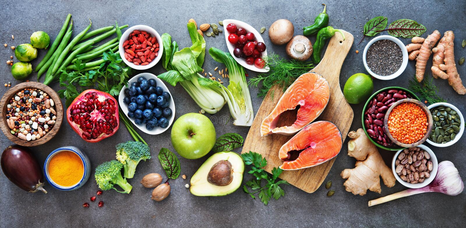 Healthy food selection. Food sources of omega 3 and unsaturated fats, fruits, vegetables, seeds, superfoods with high vitamin e and dietary fiber, cereals on stock image