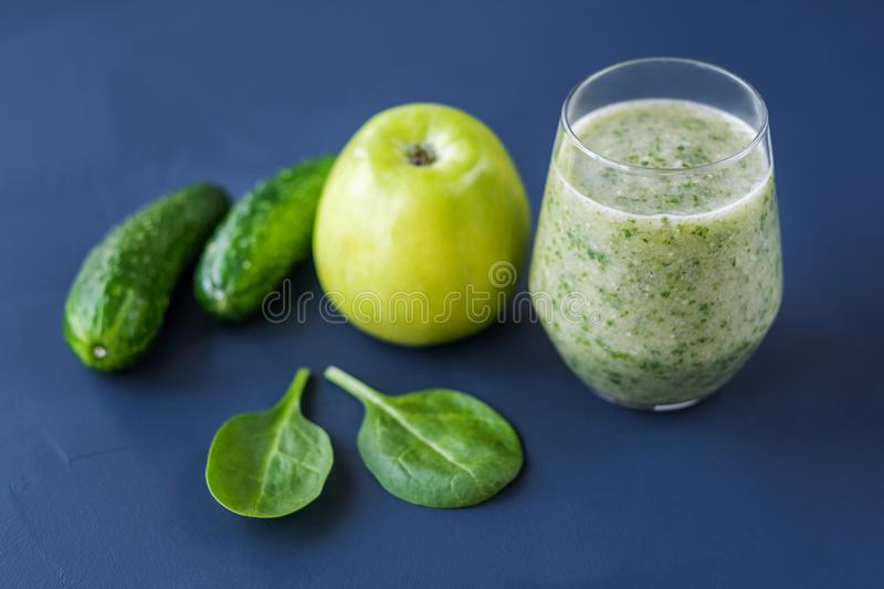 Smoothies of apples spinach cucumber. Healthy food. Smoothies of apples spinach cucumber royalty free stock photography